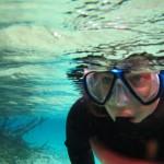 Kelley snorkeling with manatees