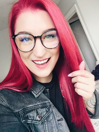 Photo of Gemma with long red hair